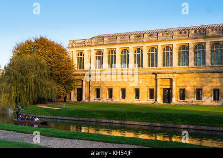 Scenic view of the Wren Library at sunset, Trinity College, Cambridge University; with punting in front on the river Cam, UK.