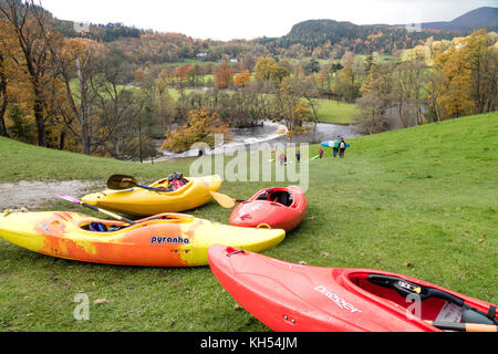 Autumn day and Kayakers on the River Dee at Horseshoe Falls near Llangollen, North Wales, UK - Stock Photo