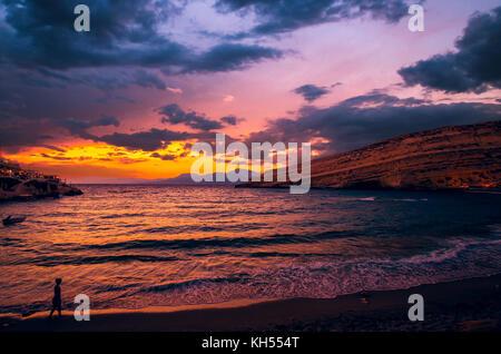 Sunset at Matala beach on Crete island, Greece - Stock Photo