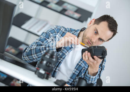 lens and camera cleaning - Stock Photo