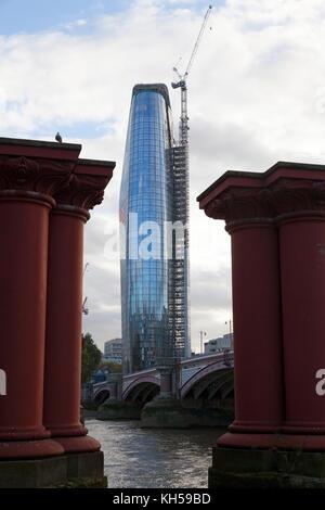 'One Blackfriars' seen between the pillars of the old Blackfriars Bridge, London - Stock Photo