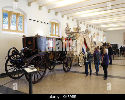 Carriages of the Dutch Royal Family on display in the stables of the het Loo Palace in Apeldoorn, Gelderland, the - Stock Photo