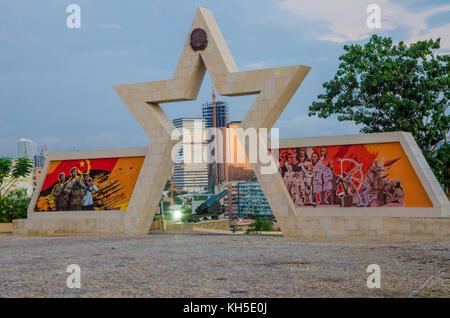 LUANDA, ANGOLA - APRIL 28 2014: Civil war memorial depicting Angolan flag and soldiers at Fortaleza de Sao Miguel - Stock Photo