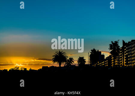 Urban sunset silhouette scene at Montevideo city, Uruguay - Stock Photo