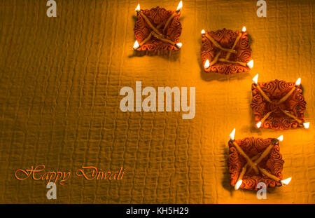 Diwali colorful decorative clay diya lamps for background greetings content - Stock Photo