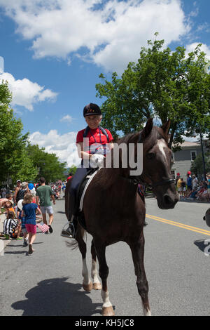 Horses and riders participate in Fourth of July parade in Williamstown, Massachusetts. - Stock Photo