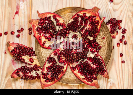 Top view of ripe pomegranate fruit on wooden background - Stock Photo