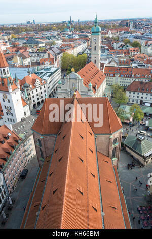 The red roof of the Peterskirche from its tower with the city center near Marienplatz - Stock Photo