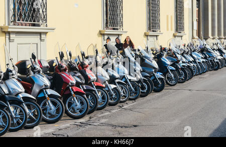 Vespas parked on street in Florence, Tuscany, Italy - Stock Photo
