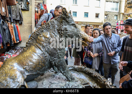 'Il Porcellino' wild boar statue at the Mercato Nuovo in Florence. Rub his snout for good luck and drop a coin - Stock Photo
