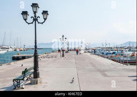 Aegina harbor on a sunny day. Aegina is a Greek island in the Aegean sea belonging to the Saronic islands. - Stock Photo