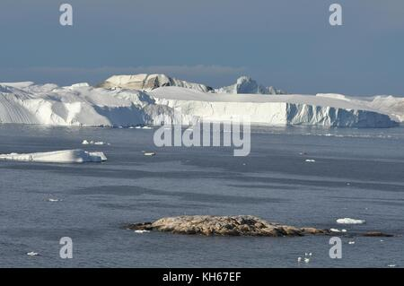 GIANT ICEBERGS OFF ILULISSAT IN DISKO BAY, GREENLAND - Stock Photo