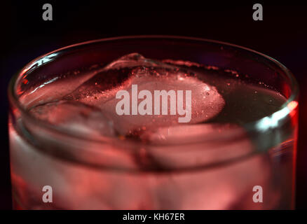 closeup of glass of drink with ice cubes - Stock Photo