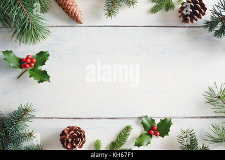 Christmas background with Christmas decorations on wooden white table. - Stock Photo