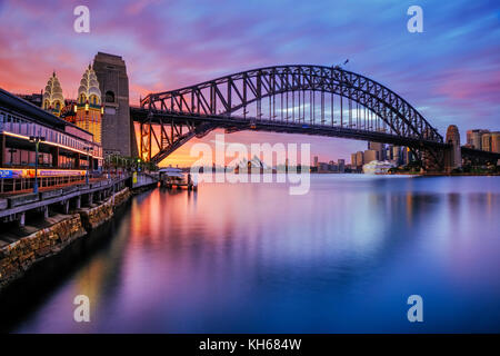 Harbour Bridge and Sydney Opera House at Sunrise, Milsons Point, Sydney, New South Wales, Australia - Stock Photo