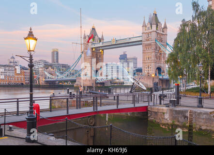 London - The Tower Bride and entry in St. Katharine docks in morning dusk. - Stock Photo