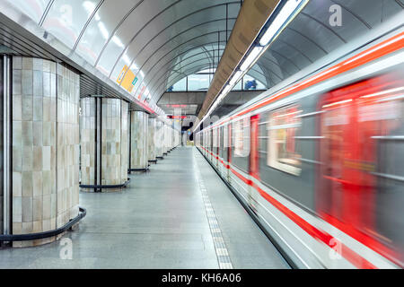 Train leaves empty platform at one of the metro stations in Prague. - Stock Photo