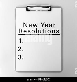 New Year's Resolution List on Clipboard. - Stock Photo