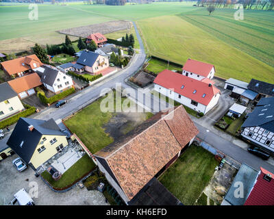 Building development with single-family houses on the edge of a village near Wolfsburg, Germany, aerial view with - Stock Photo