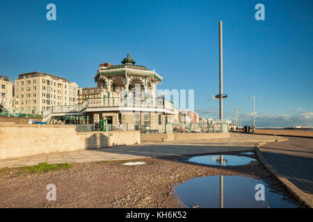 Autumn afternoon on Brighton seafront, East Sussex, England. The Bandstand and i360 tower in the distance. - Stock Photo