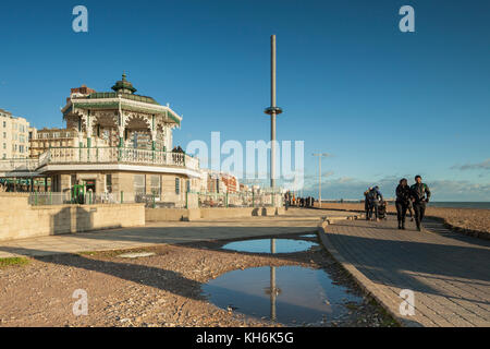 Autumn afternoon on Brighton seafront, England. The Bandstand and i360 tower in the distance. - Stock Photo