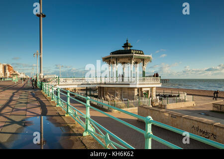 Autumn afternoon on Brighton seafront. The Bandstand and i360 tower in the distance. - Stock Photo