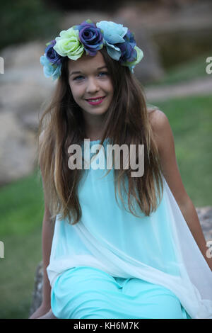 a beautiful 12 year old girl dressed up in a light blue dress, wearing a flower crown. Bat Mitzvah portfolio - Stock Photo
