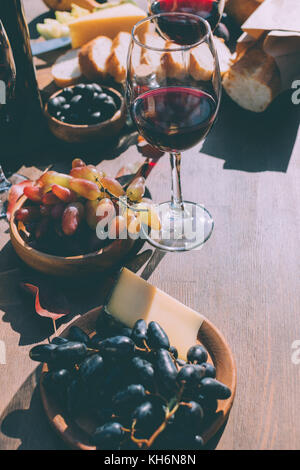 red wine with various snacks - Stock Photo