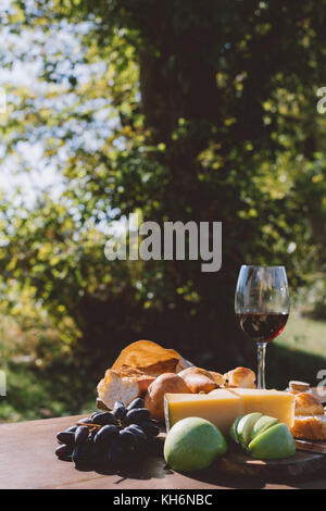 red wine with different snacks - Stock Photo