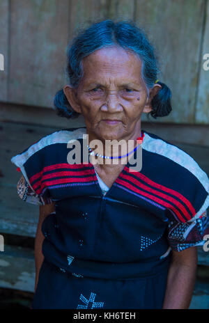 Portrait of a woman from the Cotu Minority in Quang Nam Vietnam - Stock Photo