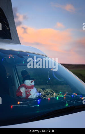 Camping in a VW campervan with christmas lights in windscreen Preseli Hills Pembrokeshire Wales - Stock Photo
