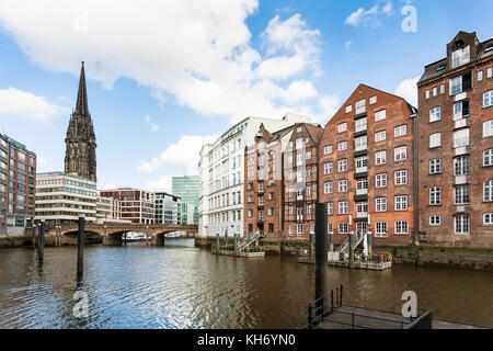 Travel to Germany - view of houses on waterfront of Nikolaifleet canal near Deichstrasse in Hamburg city downtown - Stock Photo