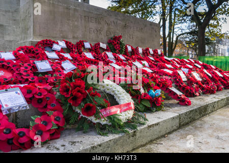 Red poppy wreaths laid during Remembrance Day commemoration at Southampton Cenotaph in November 2017, Hampshire, - Stock Photo