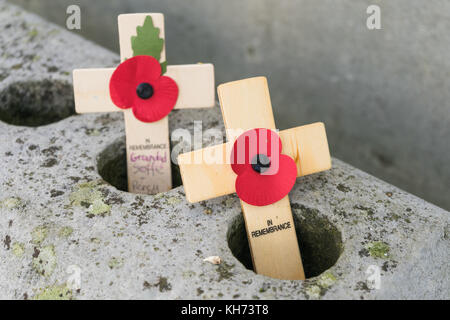 Two wooden crosses with red poppies at the Remembrance Day commemorations at the Cenotaph in Southampton, Hampshire, - Stock Photo