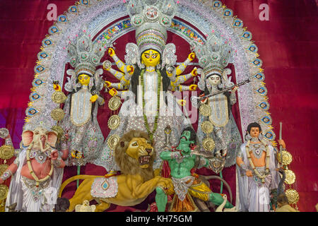 Goddess Durga along with other Hindu deities at Durga Puja festival in Kolkata, India. - Stock Photo