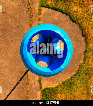 Pole aerial High Dynamic Range (HDR) image of a blue funnel ball structure on a playground. - Stock Photo
