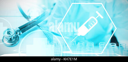 Digital background with scientist device against stethoscope on desk - Stock Photo
