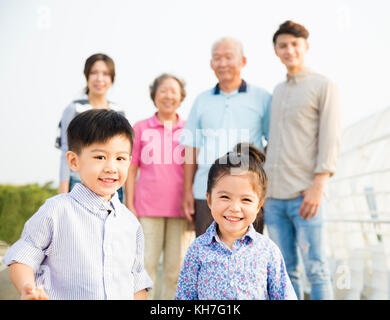 Multi-generation family having fun together outdoors - Stock Photo