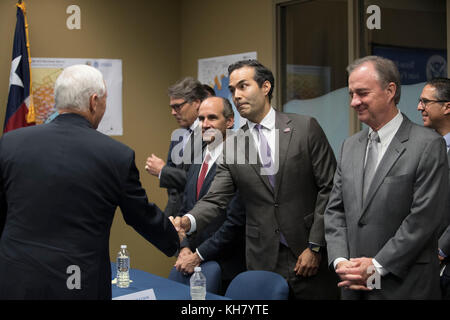 Austin, USA. 15th Nov, 2017. George P. Bush greets U.S. Vice President Mike Pence shakes hands with Texas Land Commissioner - Stock Photo