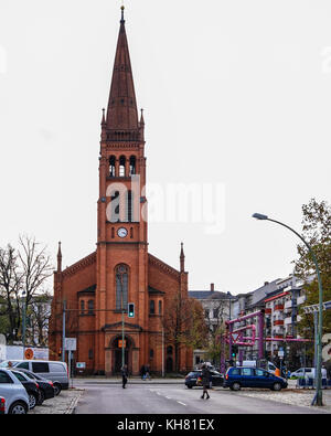 Berlin,Gethinerstrasse. Twelve Apostles Church,red brick building exterior & facade,steeple,bell tower - Stock Photo