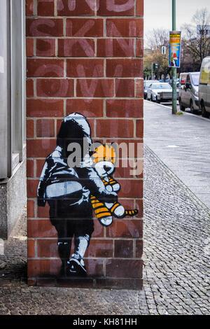 Berlin Schöneberg.Child and Teddy Bear street artwork on apartment building.URBAN NATION art project encourages - Stock Photo