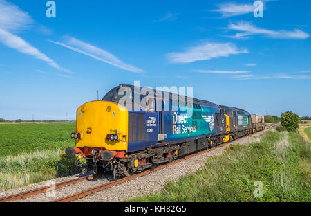 Direct Rail Services 37069 & 37602 Approach Midley Crossing on the Dungeness Branch with 6M95 the Dungeness to Crewe - Stock Photo