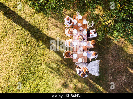 Wedding reception outside in the backyard. - Stock Photo