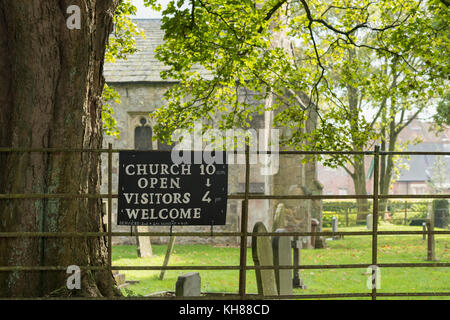 Partial view of corner of Church of Saint Margaret (Grade 1 listed building) & churchyard with headstones - Millington, - Stock Photo
