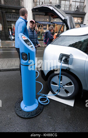 A BMW i3 electric vehicle plugged in to a charging  point, during the Regents Street Motor Show 2017 - Stock Photo