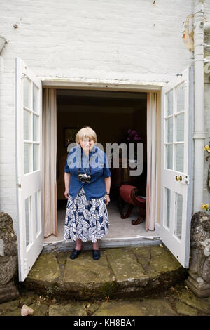 Photographer Jane Bown (13 March 1925 – 21 December 2014), full length portrait with camera - Stock Photo