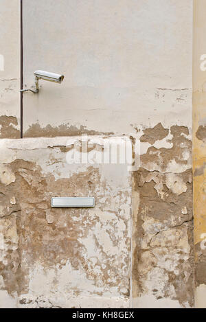 Security camera CCTV and metal plate for street name on the wall - Stock Photo
