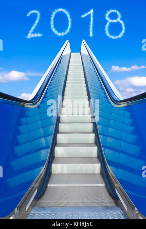 Reaching the new year 2018 on a moving stairway or escalator. Concept photo for success and reaching goals. - Stock Photo