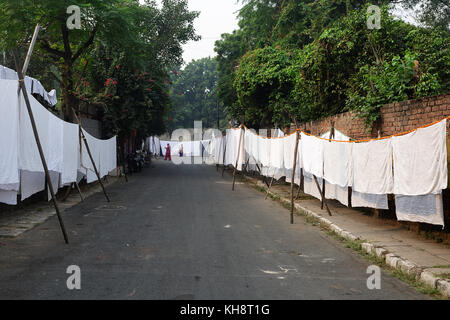 Dryings clothes and sheets on the streets of Delhi, India. - Stock Photo
