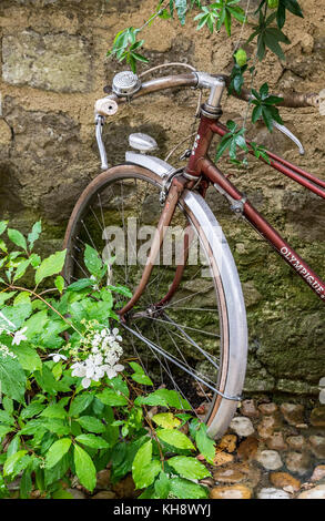 A bicycle Leaning Against a Wall in the Village  of Jean De Cole, Dordogne, France - Stock Photo